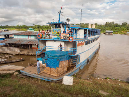 Amazon River, Peru - December 04, 2018: View of slow boat 'Victor Manuel' in the small port on the Amazon River. Amazonia. South America Editöryel