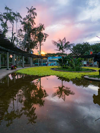 Leticia, Colombia - Nov 29, 2019: Sunset in Santander Park in a small town on the banks of the Amazon River. Leticia, Amazonia, South America