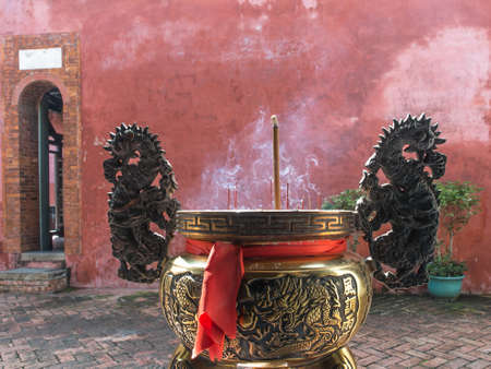 A lot of incense sticks in the pot at a temple in Taiwan