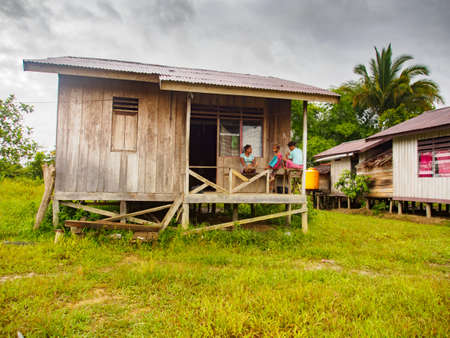 Mabul, West Papua, Indonesia - January 2015: Wooden houses on stilts in a small village built by the indonesian government for Korowai people. Asia
