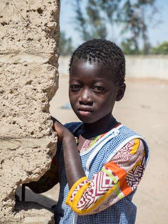 Senegal, Africa - January, 2019: Portrait of a small black girl in the school uniform. Senegal Africa.