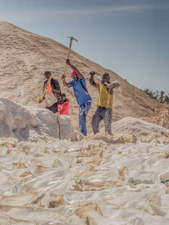 Lac Rose, Senegal, Africa (Pink Lake) - Feb 2019: Sacks of salt extracted from Retba Lake with red water. This is a UNESCO World Heritage Site. It is located north of the Cap Vert peninsula in Senegal 新闻类图片