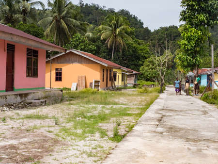 Kensi, Arguni, Indonesia - February 01, 2018: Wooden colorful houses in a small village in the Indonesian tropical forest. Bird's Head Peninsula, West Papua, Indonesia, Asia.