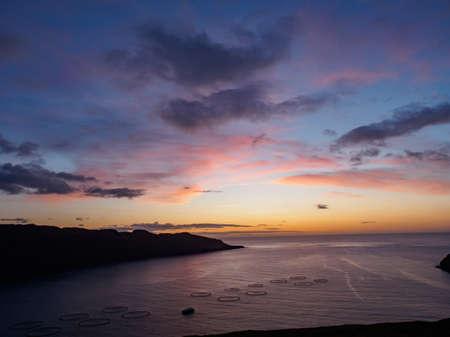 Magic sunrise with beautiful clouds over ocean on Faroe Island. Denmark. Northern Europe 免版税图像