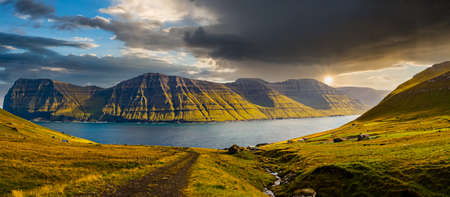 Beautiful panoramic view from Kalsoy Island to the peaks of Kunoy Island. Faroe Islands. Northern Europe