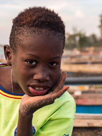 Senegal, Africa - January 24, 2019: Portrait of a small black boy with a big beautiful eyes. Senegal Africa.
