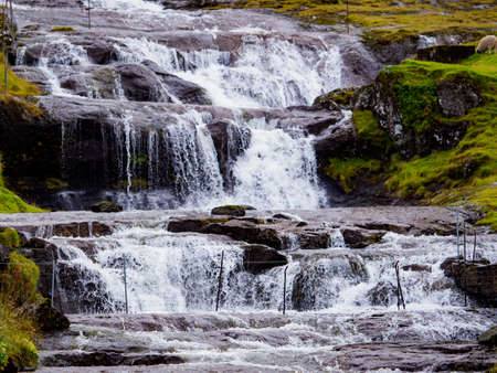 Close up for waterfall after a rainy day on the Faroe Islands, Denmark. Northern Europe.