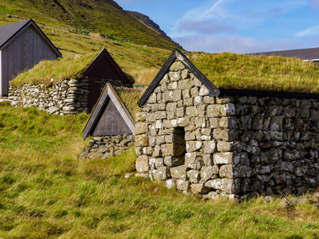 Typical stone, turf-top houses on the Kalsoy Island. Faroe Islands, Denmark, North Europe