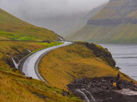 A winding road in the Faroe Islands. The road network on the Faroe Islands is highly developed. Stok Fotoğraf