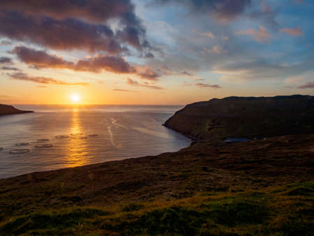 Magic sunrise with beautiful clouds over ocean on Faroe Island. Denmark. Northern Europe Stok Fotoğraf