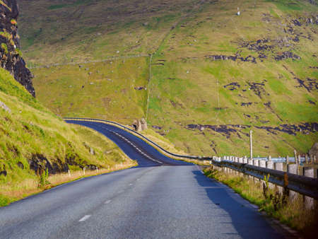 A winding road in the Faroe Islands. The road network on the Faroe Islands is highly developed. Denmark, Northern Europe