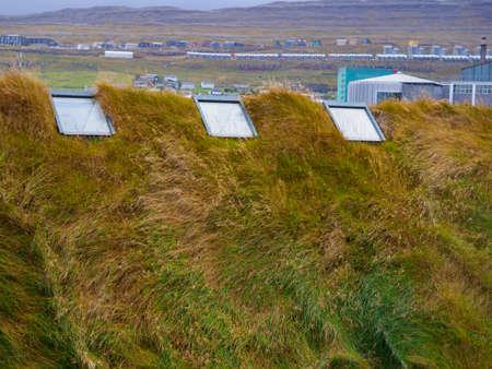 Typical turf-top houses in capital of Faroe Islands, Vagar island. Faroe Islands, Denmark, North Europe