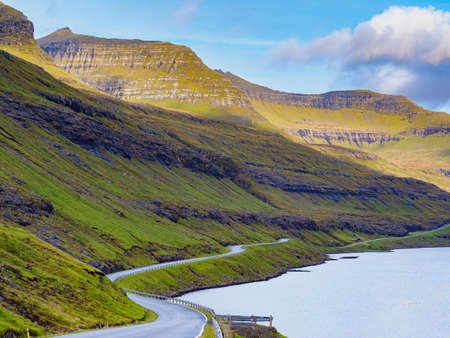 A winding road in the Faroe Islands. The road network on the Faroe Islands is highly developed. Stok Fotoğraf - 167133102