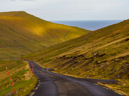 A winding road on the Eysturoy Island. The road network on the Faroe Islands is highly developed. Denmark, Northern Europe