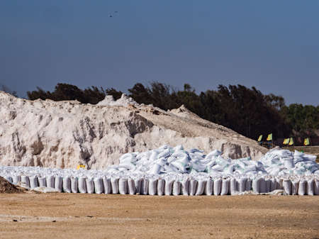 Lac Rose, Senegal, Africa (Pink Lake) - Feb 2019: Sacks of salt extracted from Retba Lake with red water. This is a UNESCO World Heritage Site. It is located north of the Cap Vert peninsula in Senegal Editöryel