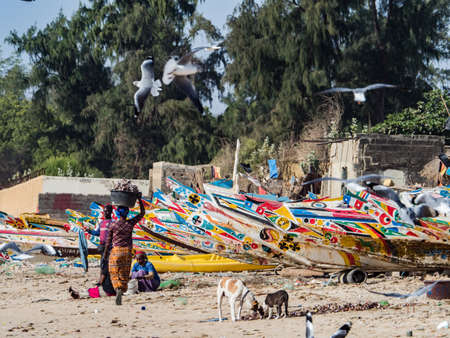 Nianing, Senegal - January 24, 2019: Colorful wooden fishing boats in Senegal, Africa Stok Fotoğraf - 167313536