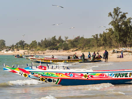Nianing, Senegal - January 24, 2019: Colorful wooden fishing boats in Senegal, Africa