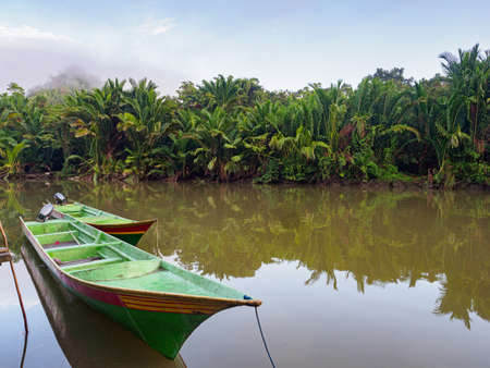 Kensi, Arguni Bay, Indonesia - Feb 2018: Wooden boats in a small village in the middle of the tropical forest during expedition to the Mairasi tribe. Bird's Head Peninsula (Teluk, Kokoroba) West Papua