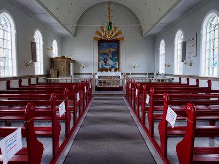 Gjógv, Faroe Island- Sep 2020: Empty benches in the church during the coronavirus era (COVID-19). Gjogv. Denmark