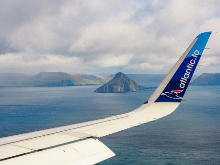 Faroe Islands, Denmark - Oct 2020: Wing of an Atlantic Airways jet during landing on Faroe Islands. Atlantic is the national airline of the Faroe Islands. North Europe