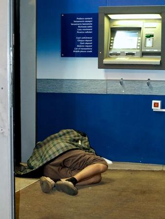 Homeless sleeping in a Bank photo