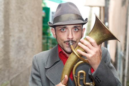 Rome, Italy, november 2013, a street artist playing brass