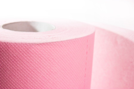 isolated pink toilet paper on white background photo