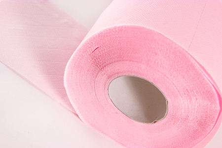 isolated pink toilet paper on white background Stock Photo - 22705174