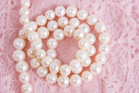 pearl on pink curve background. macro jewelry photo