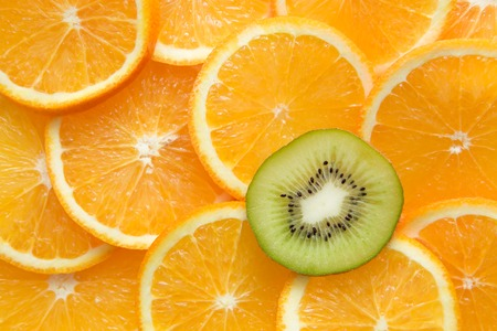 orange and kiwi on plate. be different.  photo