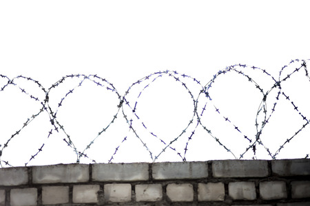 barbed wire with wall on white photo