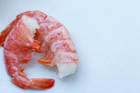 row tiger shrimp with lemon on white