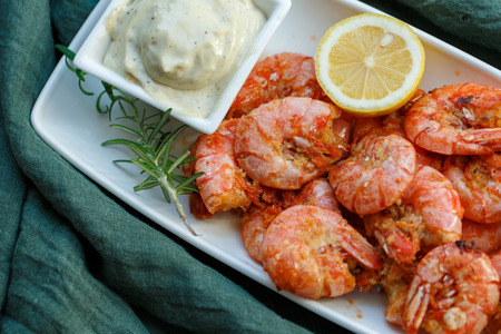 row tiger shrimp with lemon on green