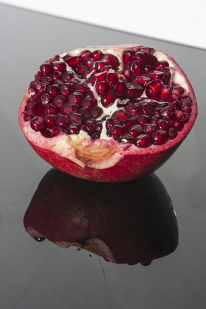 The pomegranate, botanical name Punica granatum, is a fruit-bearing deciduous shrub or small tree growing between 5–8 meters tall. The pomegranate is widely considered to have originated in Iran and has been cultivated since ancient times. photo