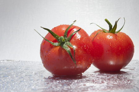 The tomato is the edible, often red fruit of the plant Solanum lycopersicum, commonly known as a tomato plant. photo