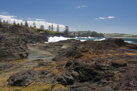 blowhole: The Kiama Blowhole is a blowhole in the town of Kiama, New South Wales, Australia.  Stock Photo