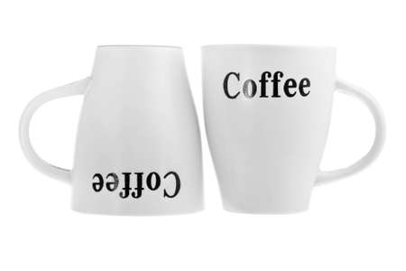 next to each other: Two white coffee cups one upside-down isolated on white