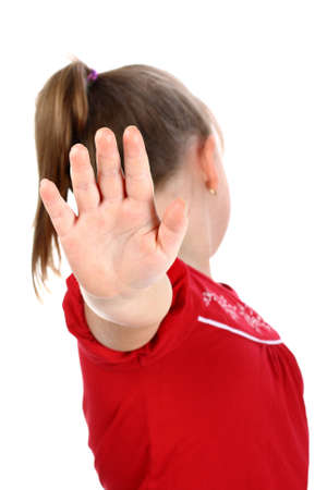 turn away: Small girl shows denial with her hand isolated on white Stock Photo