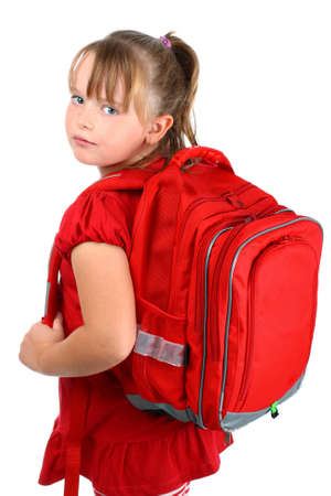 looking over shoulder: Small girl with red school bag isolated on white