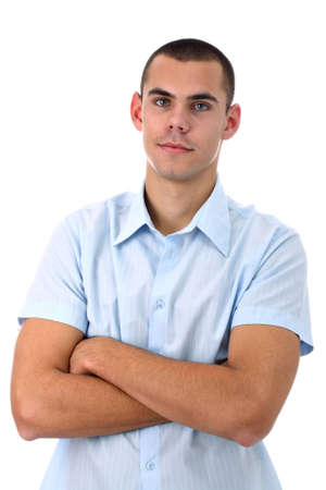 Young man in blue shirt with arms crossed isolated on white Stock Photo - 9974718