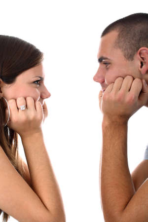 looking at each other: Young couple looking at each other isolated on white