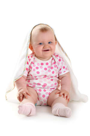Cute smiling baby under towel isolated on white with shadow photo