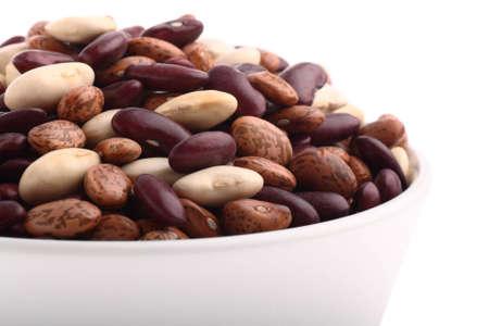 common bean: Various bean types in white bowl isolated on white Stock Photo