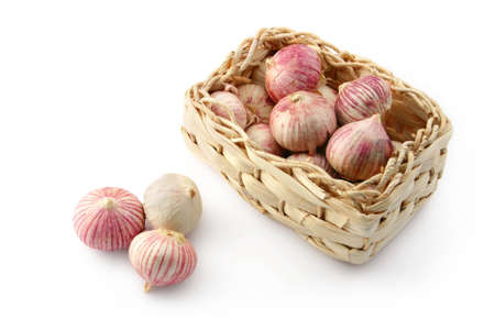 Garlic in a wicker basket Stock Photo - 9974707