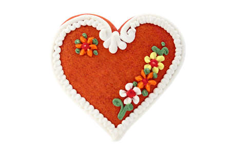 A sweet gingerbread heart with decorations; isolated on white. photo