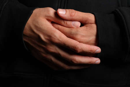 Folded hands of a priest photo