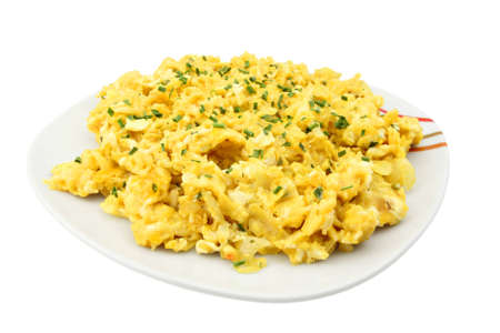 scrambled: Scrambled eggs on a plate, decorated with chives, isolated on white