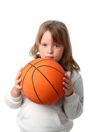 pre schooler: Small girl with long hair holding basketball isolated on white