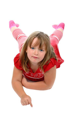 advertisment: Small girl lying on floor pointing her finger to something isolated on white