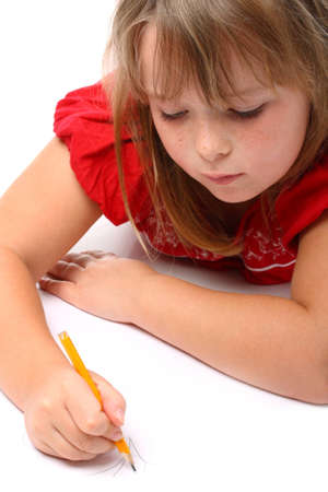 Small girl drawing something with a pencil isolated on white Stock Photo - 10615777